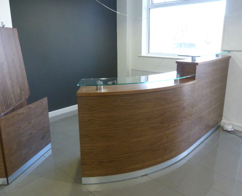 Colman Milne Tula Reception Counter in Walnut with an Open Door
