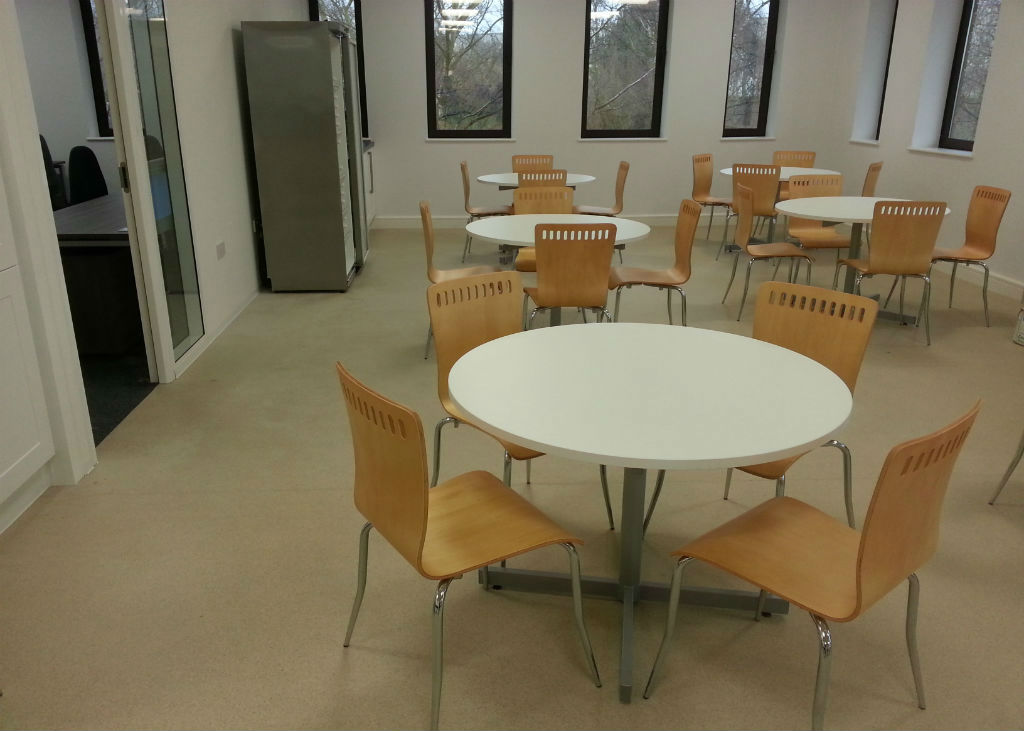 Liberata in Liverpool Bistro Area with Circular Tables & Wooden Chairs