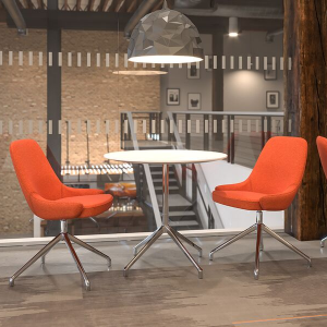 Product picture of the circular white Era Table on chrome base, next to two red breakout upholstered chairs