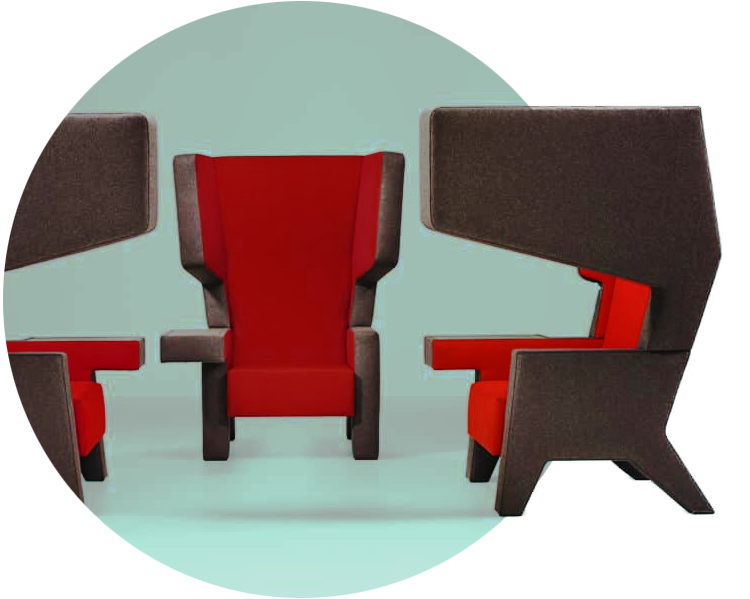 An image of three acoustic Ear Chairs finished in red and grey fabric