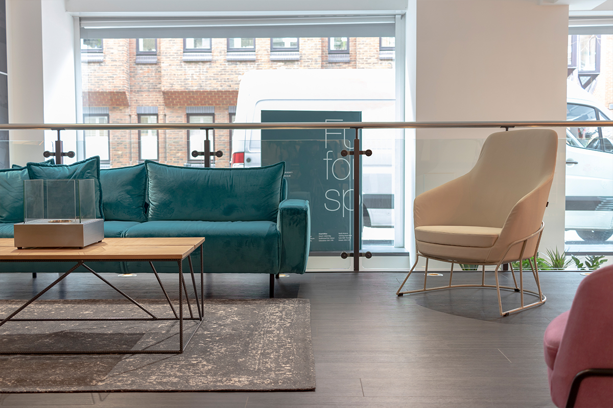 Image a sofa, chair and a coffee table within a reception area
