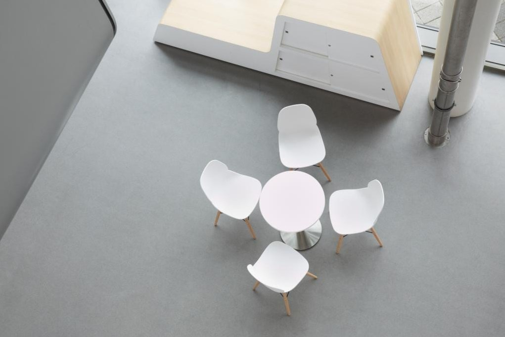 chairs next to a poser table