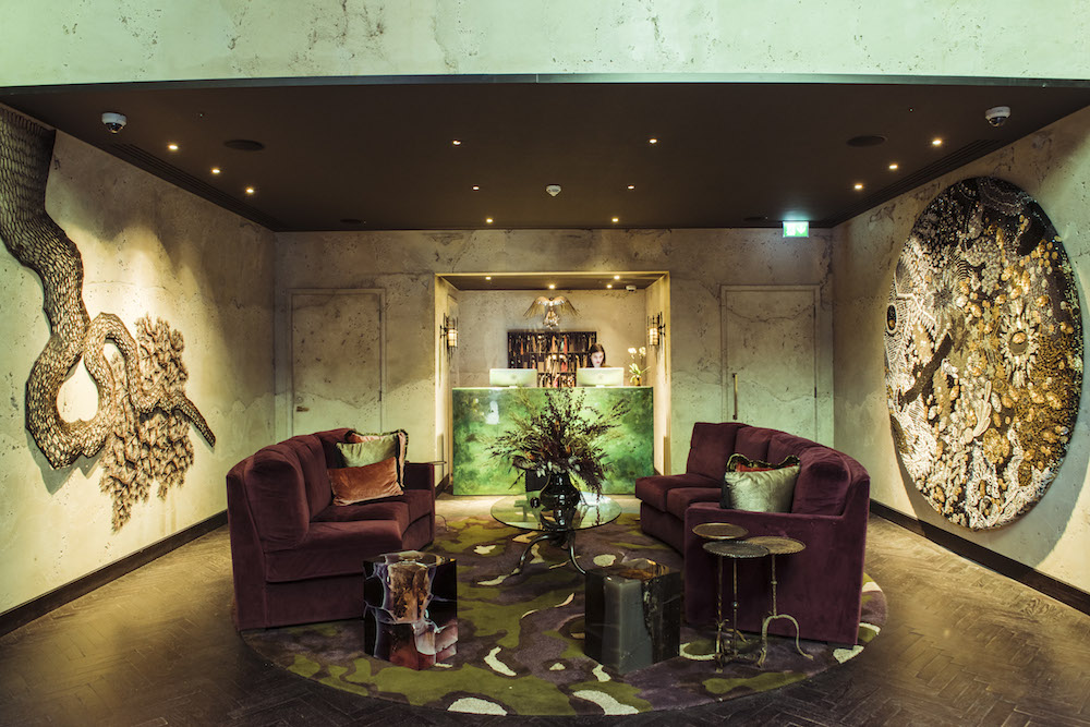 Image of soft seating sofas in The Mandrake Hotel with exposed stone walls