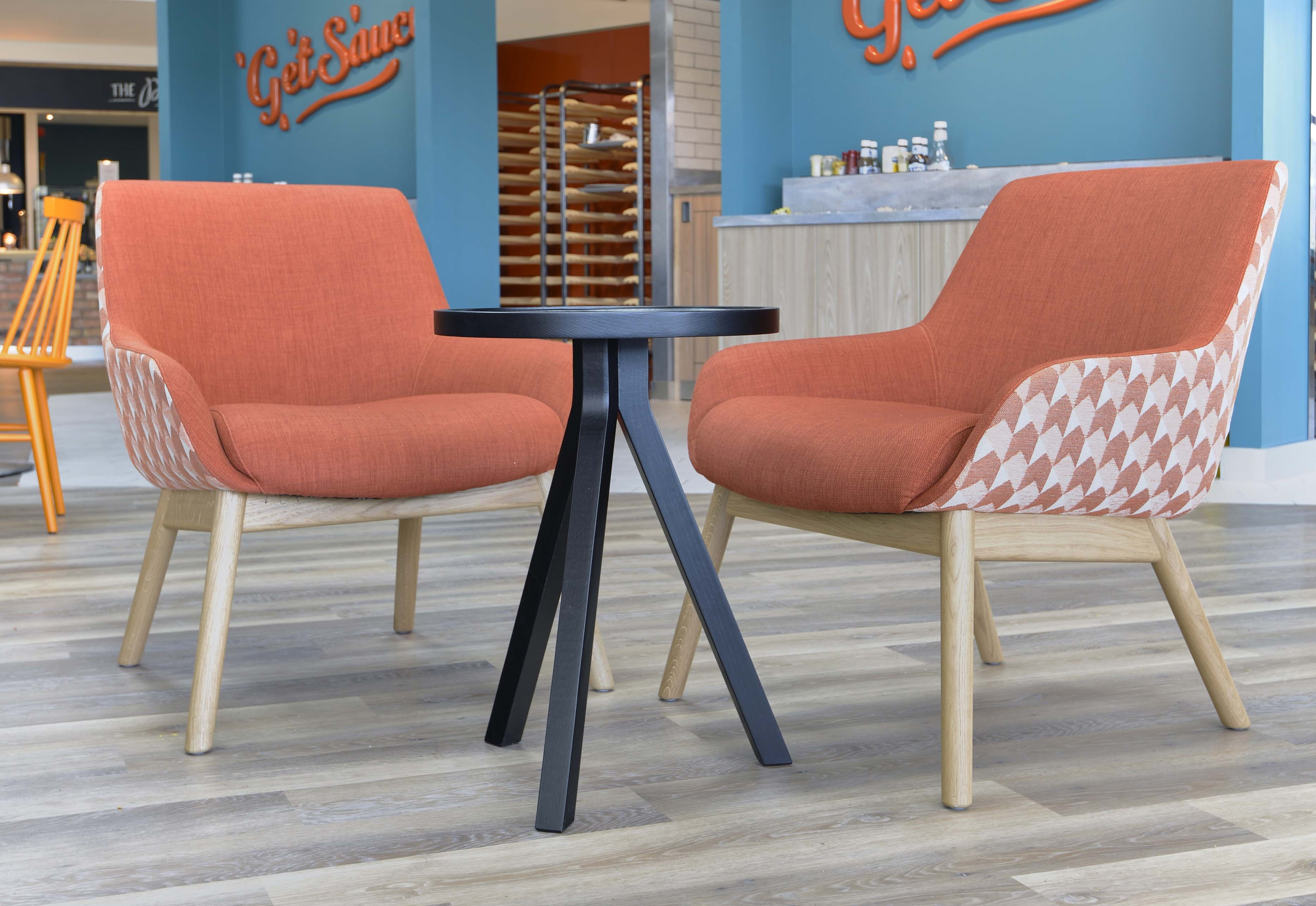 Image of two dual-tone chairs on wooden legs